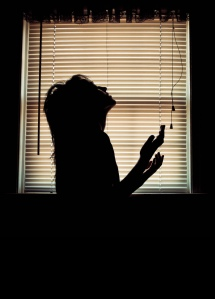 woman in worship in dark room
