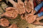 Poor people in Ethiopia keeping their hands up.